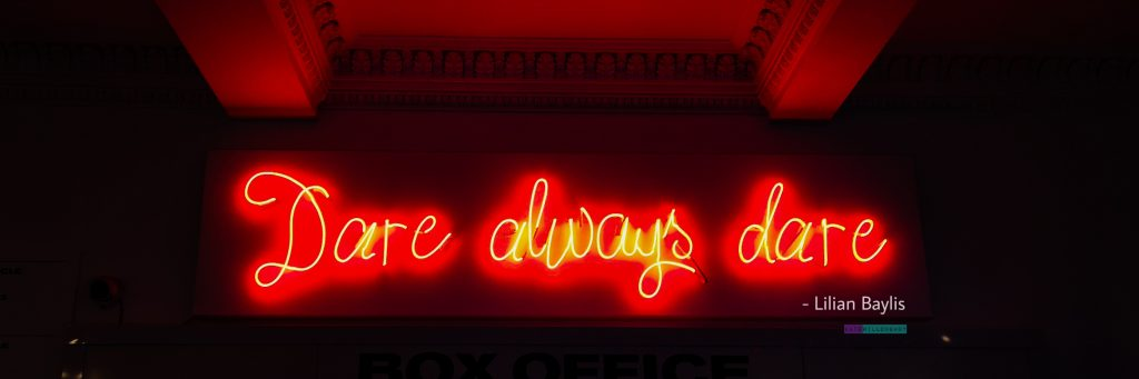 Dare always dare - Lilian Baylis quote in red neon light