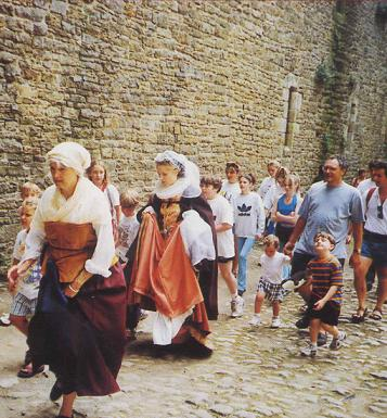 Marie Stuart - Fleur d'Ecosse performance at Bolton Castle. Marie with maidservant and audience in Bolton Castle courtyard.
